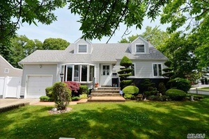 Welcome home to this Expanded Cape Cod style home, a large Kitchen anchors this 4 Bedroom, 2 Bath home located just close enough to the LIRR local parks ball fields, ...